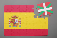 Puzzle with national flag of Spain and Basque Country piece detached. Royalty Free Stock Photo