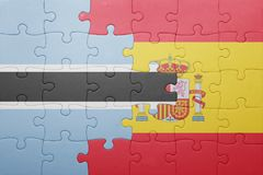 Puzzle with the national flag of spain and botswana Stock Image
