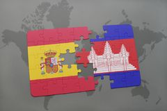 Puzzle with the national flag of spain and cambodia on a world map background. 3D illustration Royalty Free Stock Images