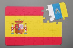 Puzzle with national flag of Spain and canary islands piece detached. Concept Royalty Free Stock Photography