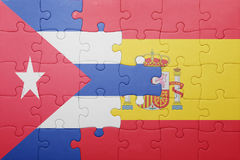 Puzzle with the national flag of spain and cuba. Concept Royalty Free Stock Photography