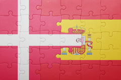 Puzzle with the national flag of spain and denmark. Concept Stock Images