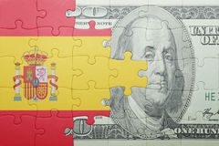 Puzzle with the national flag of spain and dollar banknote. Concept vector illustration