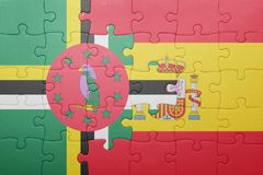 Puzzle with the national flag of spain and dominica. Concept stock images