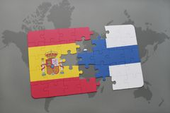 Puzzle with the national flag of spain and finland on a world map background. 3D illustration Stock Photography