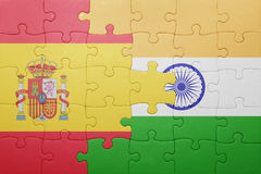 Puzzle with the national flag of spain and india Stock Image