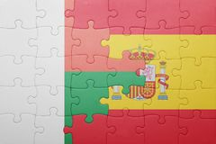 Puzzle with the national flag of spain and madagascar. Concept Royalty Free Stock Photos