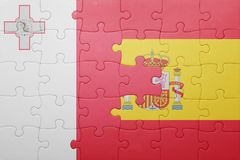 Puzzle with the national flag of spain and malta. Concept Royalty Free Stock Photography