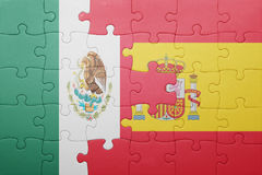 Puzzle with the national flag of spain and mexico. Concept royalty free stock image