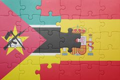 Puzzle with the national flag of spain and mozambique. Concept Royalty Free Stock Photo