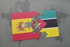 Puzzle with the national flag of spain and mozambique on a world map background. 3D illustration Royalty Free Stock Images