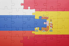 Puzzle with the national flag of spain and russia Stock Image