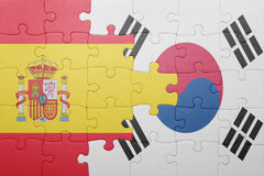 Puzzle with the national flag of spain and south korea. Concept royalty free stock photos