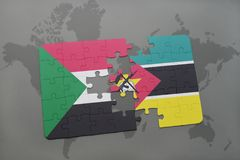 Puzzle with the national flag of sudan and mozambique on a world map Stock Image