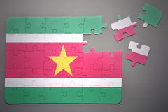 Puzzle with the national flag of suriname Stock Photography