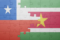 Puzzle with the national flag of suriname and chile Royalty Free Stock Photo