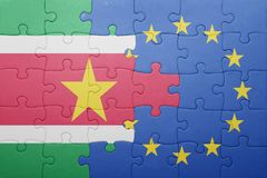 Puzzle with the national flag of suriname and european union Royalty Free Stock Photo