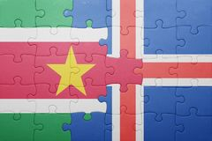 Puzzle with the national flag of suriname and iceland. Concept Stock Photography