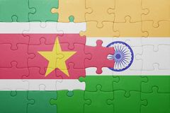 Puzzle with the national flag of suriname and india. Cotncept Stock Image