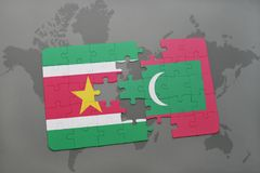 Puzzle with the national flag of suriname and maldives on a world map. Background. 3D illustration Royalty Free Stock Photo