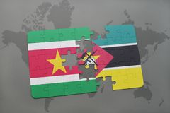 Puzzle with the national flag of suriname and mozambique on a world map. Background. 3D illustration Royalty Free Stock Photography
