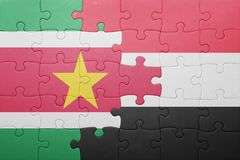 Puzzle with the national flag of suriname and yemen. Concept Royalty Free Stock Photo