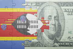 Puzzle with the national flag of swaziland and dollar banknote Royalty Free Stock Image