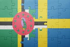 Puzzle with the national flag of sweden and dominica. Concept royalty free stock images