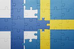 Puzzle with the national flag of sweden and finland Stock Photos