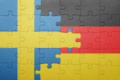 Puzzle with the national flag of sweden and germany. Concept Royalty Free Stock Image