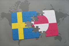 Puzzle with the national flag of sweden and greenland on a world map background. Royalty Free Stock Photo