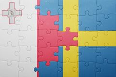 Puzzle with the national flag of sweden and malta. Concept Royalty Free Stock Image