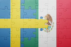 Puzzle with the national flag of sweden and mexico. Concept royalty free stock photos