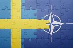 Puzzle with the national flag of sweden and nato. Concept stock photography