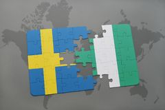 Puzzle with the national flag of sweden and nigeria on a world map background. Stock Images