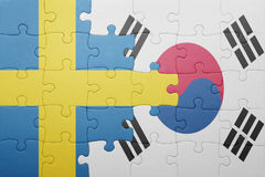 Puzzle with the national flag of sweden and south korea. Concept stock photography