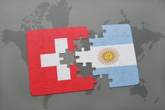 Puzzle with the national flag of switzerland and argentina on a world map background. Royalty Free Stock Image