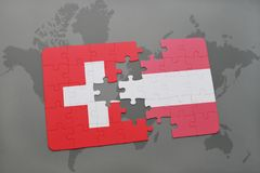 Puzzle with the national flag of switzerland and austria on a world map background. 3D illustration Royalty Free Stock Images