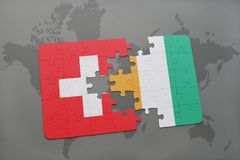 Puzzle with the national flag of switzerland and cote divoire on a world map background. 3D illustration Royalty Free Stock Images