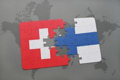 Puzzle with the national flag of switzerland and finland on a world map background. Royalty Free Stock Images