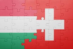 Puzzle with the national flag of switzerland and hungary. Concept Royalty Free Stock Photos
