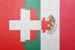 Puzzle with the national flag of switzerland and mexico. Concept royalty free stock photo