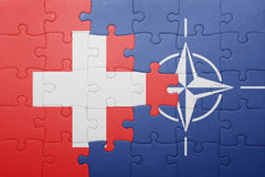 Puzzle with the national flag of switzerland and nato Stock Photography