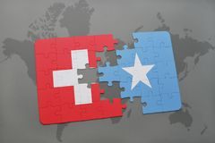 Puzzle with the national flag of switzerland and somalia on a world map background. 3D illustration royalty free stock photos
