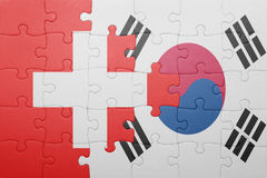 Puzzle with the national flag of switzerland and south korea. Concept royalty free stock photos