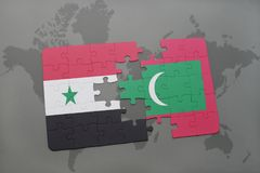 Puzzle with the national flag of syria and maldives on a world map background. Stock Image