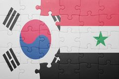 Puzzle with the national flag of syria and south korea. Concept stock photo