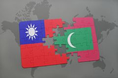 Puzzle with the national flag of taiwan and maldives on a world map background. Stock Image