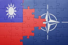 Puzzle with the national flag of taiwan and nato Royalty Free Stock Photography