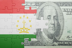 Puzzle with the national flag of tajikistan and dollar banknote Royalty Free Stock Photos